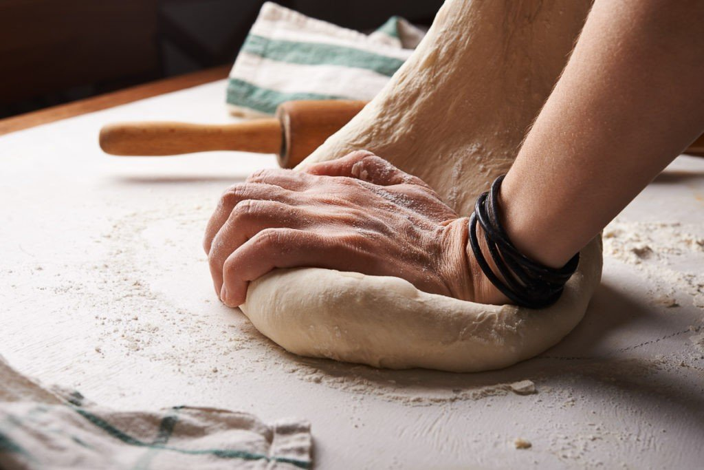 Pizza dough making, hard work for artists pizza makers