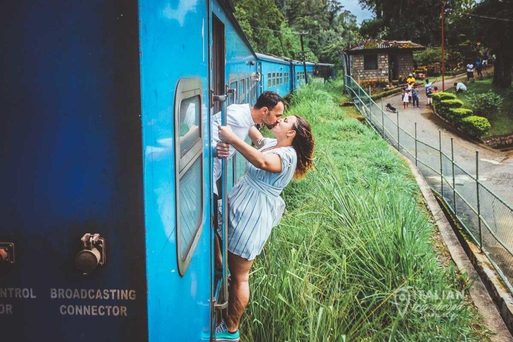 Couple on a blue train in Sri Lanka