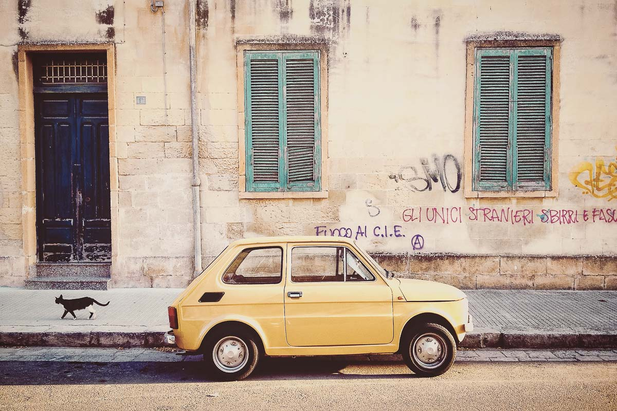A classic Italian Car in a pictoresque town in Sicily