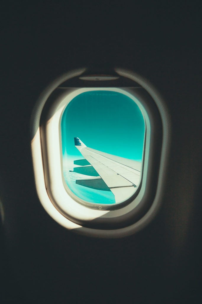 Fly over the clouds - View over the window of an aircraft