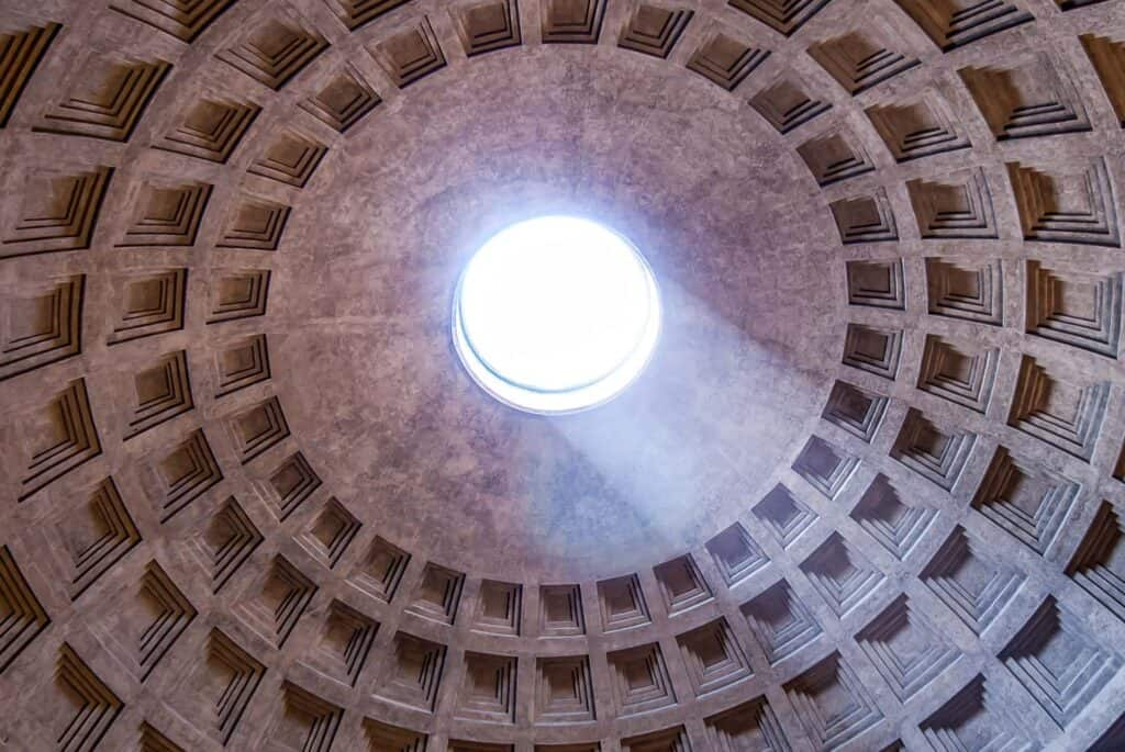 Have a look about the ceiling of the dome of the Pantheon - The insane architecture with a hole in the middle is filtering so much light in!